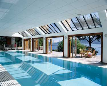 Your exclusive open air pool solarlux swimming pool glazing for Open door swimming pool london